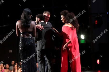 """Jharrel Jerome, Angela Bassett, Peter Krause. Jharrel Jerome, left, accepts the award for outstanding lead actor in a limited series or movie for """"When They See Us,"""" from Peter Krause and Angela Bassett at the 71st Primetime Emmy Awards, at the Microsoft Theater in Los Angeles"""
