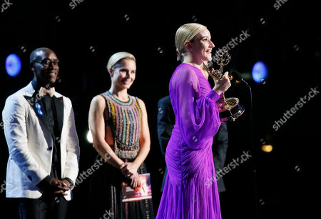 "Don Cheadle, Kristen Bell, Julia Garner. Julia Garner accepts the award for outstanding supporting actress in a drama series for ""Ozark"" at the 71st Primetime Emmy Awards, at the Microsoft Theater in Los Angeles"