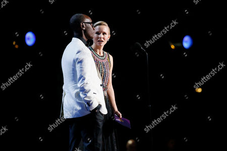 Don Cheadle, Kristen Bell. Don Cheadle, left, and Kristen Bell present the award for outstanding supporting actress in a drama series at the 71st Primetime Emmy Awards, at the Microsoft Theater in Los Angeles