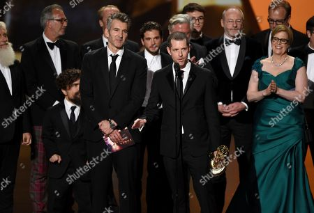 """David Benioff, D. B. Weiss. David Benioff, center left, and D. B. Weiss accept the award for outstanding drama series for """"Game Of Thrones"""" at the 71st Primetime Emmy Awards, at the Microsoft Theater in Los Angeles"""