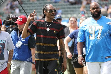 Musician Snoop Dog (C) greets fans before the NFL American Football game between the Houston Texans and the Los Angeles Chargers at the Dignity Health Sports Park in Carson, California, USA, 22 September 2019.