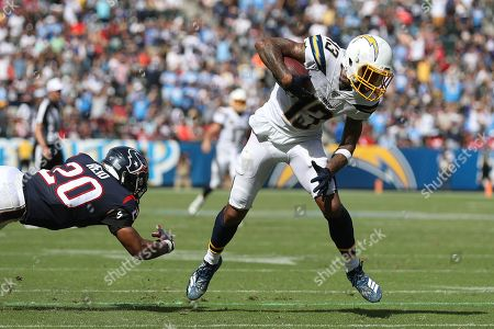 Los Angeles Chargers wide receiver Keenan Allen (R) jukes a tackle attempt by Houston Texans strong safety Justin Reid (L) leading to a touchdown just before halftime during the NFL American Football game between the Houston Texans and the Los Angeles Chargers at the Dignity Health Sports Park in Carson, California, USA, 22 September 2019.