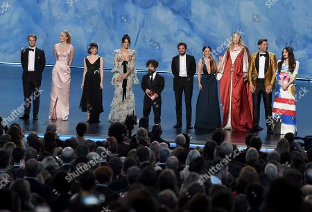 """Alfie Allen, Sophie Turner, Maisie Williams, Lena Headey, Peter Dinklage, Kit Harington Emilia Clarke, Gwendoline Christie, Nikolaj Coster-Waldau, Carice van Houten. The cast of """"Game of Thrones"""" appear on stage to present the award for outstanding supporting actress in a limited series or movie at the 71st Primetime Emmy Awards, at the Microsoft Theater in Los Angeles. From left are, Alfie Allen, Sophie Turner, Maisie Williams, Lena Headey, Peter Dinklage, Kit Harington Emilia Clarke, Gwendoline Christie, Nikolaj Coster-Waldau and Carice van Houten"""