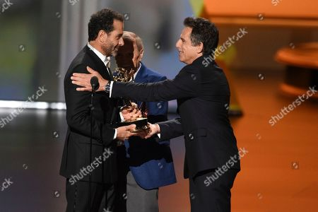 Ben Stiller, Bob Newhart, Tony Shalhoub. Ben Stiller, from right, and Bob Newhart present the award for outstanding supporting actor in a comedy series to Tony Shalhoub at the 71st Primetime Emmy Awards, at the Microsoft Theater in Los Angeles