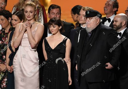 "Emilia Clarke, Sophie Turner, Maisie Williams, Alfie Allen, George R. R. Martin. Emilia Clarke, from left, Sophie Turner, Maisie Williams, Alfie Allen, George R. R. Martin and crew of ""Game Of Thrones"" accept the award for outstanding drama series at the 71st Primetime Emmy Awards, at the Microsoft Theater in Los Angeles"