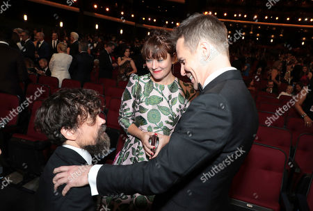 Peter Dinklage, Erica Schmidt, Sam Rockwell. Peter Dinklage, from left, Erica Schmidt, and Sam Rockwell in the audience at the 71st Primetime Emmy Awards, at the Microsoft Theater in Los Angeles