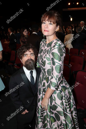 Peter Dinklage, Erica Schmidt. Peter Dinklage, left, and Erica Schmidt pose in the audience at the 71st Primetime Emmy Awards, at the Microsoft Theater in Los Angeles