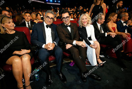 Eugene Levy, Daniel Levy, Catherine O'Hara. Eugene Levy, from left, Daniel Levy, and Catherine O'Hara in the audience at the 71st Primetime Emmy Awards, at the Microsoft Theater in Los Angeles