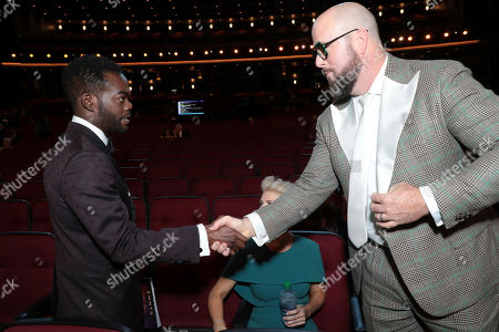 Stock Image of William Jackson Harper, Chris Sullivan. William Jackson Harper, left, and Chris Sullivan shake hands in the audience at the 71st Primetime Emmy Awards, at the Microsoft Theater in Los Angeles