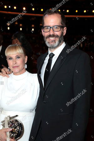 Patricia Arquette, Eric White. Patricia Arquette, left, and Eric White pose in the audience at the 71st Primetime Emmy Awards, at the Microsoft Theater in Los Angeles