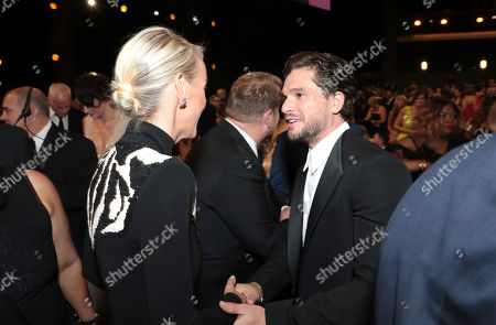 Stock Picture of Julia Carey, Kit Harington. Julia Carey, left, and Kit Harington speak in the audience at the 71st Primetime Emmy Awards, at the Microsoft Theater in Los Angeles
