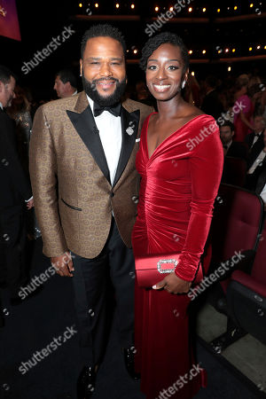 Stock Image of Anthony Anderson, Alvina Stewart. Anthony Anderson, left, and Alvina Stewart pose in the audience at the 71st Primetime Emmy Awards, at the Microsoft Theater in Los Angeles
