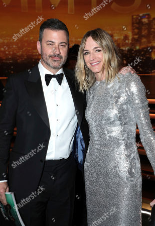 Stock Photo of Jimmy Kimmel, Molly McNearney. Jimmy Kimmel, left, and Molly McNearney pose in the audience at the 71st Primetime Emmy Awards, at the Microsoft Theater in Los Angeles