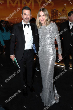 Stock Image of Jimmy Kimmel, Molly McNearney. Jimmy Kimmel, left, and Molly McNearney pose in the audience at the 71st Primetime Emmy Awards, at the Microsoft Theater in Los Angeles