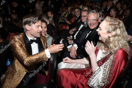 Stock Image of Nikolaj Coster-Waldau, Nukaaka Coster-Waldau, Gwendoline Christie, Giles Deacon. Nikolaj Coster-Waldau, from left, Nukaaka Coster-Waldaua, Gwendoline Christie and Giles Deacon speak in the audience at the 71st Primetime Emmy Awards, at the Microsoft Theater in Los Angeles