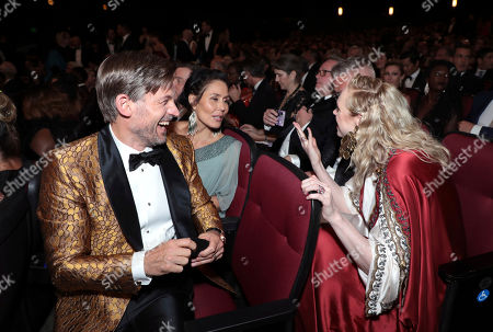 Stock Picture of Nikolaj Coster-Waldau, Nukaaka Coster-Waldau, Gwendoline Christie, Giles Deacon. Nikolaj Coster-Waldau, from left, Nukaaka Coster-Waldaua, Gwendoline Christie and Giles Deacon speak in the audience at the 71st Primetime Emmy Awards, at the Microsoft Theater in Los Angeles