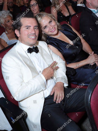 Stock Image of John Leguizamo, Justine Maurer. John Leguizamo, left, and Justine Maurer pose in the audience at the 71st Primetime Emmy Awards, at the Microsoft Theater in Los Angeles