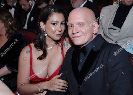 Stock Picture of Gia Olimp, Anthony Carrigan. Anthony Carrigan, right, and Gia Olimp pose in the audience at the 71st Primetime Emmy Awards, at the Microsoft Theater in Los Angeles