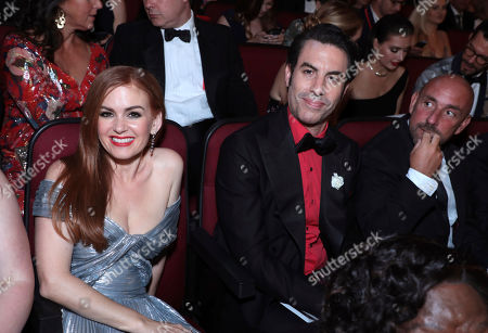 Isla Fisher, Sacha Baron Cohen. Isla Fisher, left, and Sacha Baron Cohen pose in the audience at the 71st Primetime Emmy Awards, at the Microsoft Theater in Los Angeles