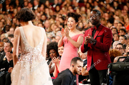 Phoebe Waller-Bridge, Sandra Oh, Sterling K. Brown. Phoebe Waller-Bridge, from left, Sandra Oh and Sterling K. Brown are in the audience at the 71st Primetime Emmy Awards, at the Microsoft Theater in Los Angeles