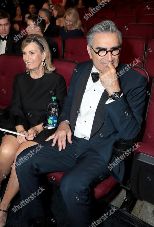 Deborah Divine, Eugene Levy. Deborah Divine, left, and Eugene Levy in the audience at the 71st Primetime Emmy Awards, at the Microsoft Theater in Los Angeles