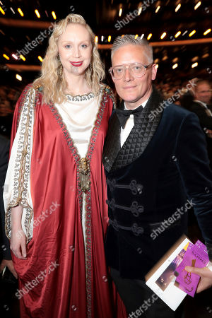 Gwendoline Christie, Giles Deacon. Gwendoline Christie, left, and Giles Deacon pose in the audience at the 71st Primetime Emmy Awards, at the Microsoft Theater in Los Angeles