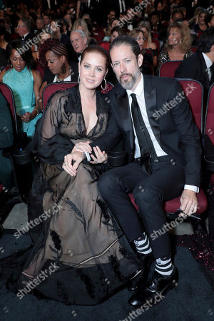 Stock Image of Amy Adams, Darren Le Gallo. Amy Adams, left, and Darren Le Gallo pose in the audience at the 71st Primetime Emmy Awards, at the Microsoft Theater in Los Angeles