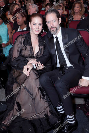 Amy Adams, Darren Le Gallo. Amy Adams, left, and Darren Le Gallo pose in the audience at the 71st Primetime Emmy Awards, at the Microsoft Theater in Los Angeles