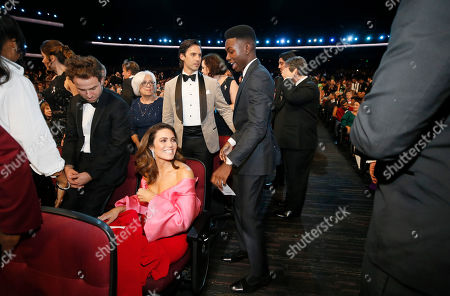 Mandy Moore, Milo Ventimiglia, Niles Fitch. Mandy Moore, from left, Milo Ventimiglia and Niles Fitch are in the audience at the 71st Primetime Emmy Awards, at the Microsoft Theater in Los Angeles