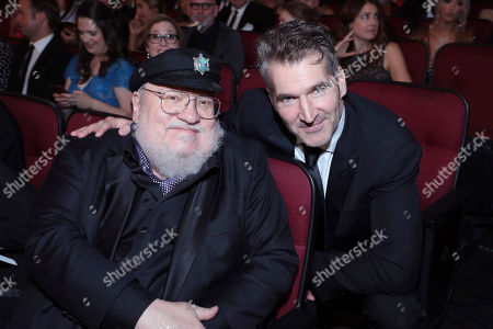 George R. R. Martin, David Benioff. George R. R. Martin, left, and David Benioff pose in the audience at the 71st Primetime Emmy Awards, at the Microsoft Theater in Los Angeles