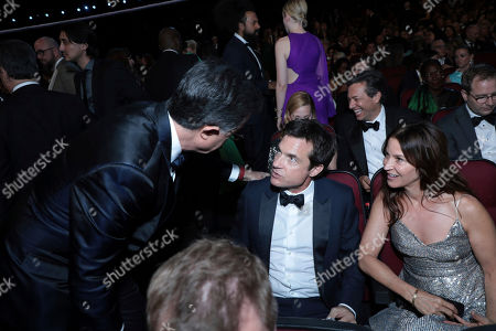 Stock Picture of Stephen Colbert, Jason Bateman, Amanda Anka. Stephen Colbert, from left, Jason Bateman, and Amanda Anka speak in the audience at the 71st Primetime Emmy Awards, at the Microsoft Theater in Los Angeles