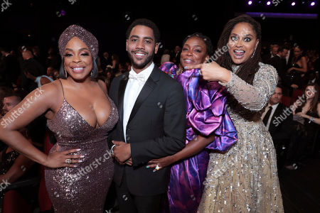 Stock Picture of Niecy Nash, Jharrel Jerome, Aunjanue Ellis, Ava DuVernay. Niecy Nash, from left, Jharrel Jerome, Aunjanue Ellis, and Ava DuVernay pose in the audience at the 71st Primetime Emmy Awards, at the Microsoft Theater in Los Angeles