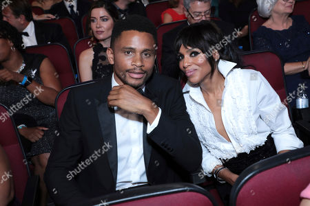 Nnamdi Asomugha, Kerry Washington. Nnamdi Asomugha, left, and Kerry Washington pose in the audience at the 71st Primetime Emmy Awards, at the Microsoft Theater in Los Angeles