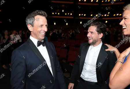 Seth Meyers, Kit Harington, Lindsay Shookus. Seth Meyers, from left, Kit Harington, and Lindsay Shookus speak in the audience at the 71st Primetime Emmy Awards, at the Microsoft Theater in Los Angeles