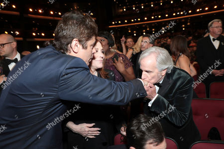 Benicio del Toro, Stacey Weitzman, Henry Winkler. Benicio del Toro, from left, Stacey Weitzman, and Henry Winkler embrace int the audience at the 71st Primetime Emmy Awards, at the Microsoft Theater in Los Angeles
