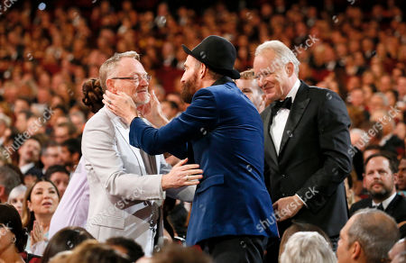 Jared Harris, Johan Renck, Stellan Skarsgard. Johan Renck, right, embraces Jared Harris at the audience at the 71st Primetime Emmy Awards, at the Microsoft Theater in Los Angeles