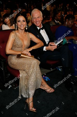 Stock Picture of Julia Louis-Dreyfus, Brad Hall. Julia Louis-Dreyfus, left, and Brad Hall in the audience at the 71st Primetime Emmy Awards, at the Microsoft Theater in Los Angeles