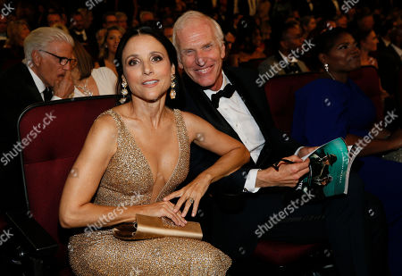 Julia Louis-Dreyfus, Brad Hall. Julia Louis-Dreyfus, left, and Brad Hall in the audience at the 71st Primetime Emmy Awards, at the Microsoft Theater in Los Angeles