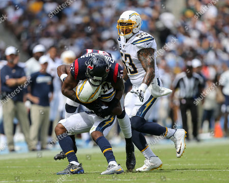 Carson, CA...Houston Texans inside linebacker Zach Cunningham #41 tackles Los Angeles Chargers running back Justin Jackson #22 during the NFL Houston Texans vs Los Angeles Chargers at the Dignity Health Sports Park in Carson, Ca on , (Photo by Jevone Moore)