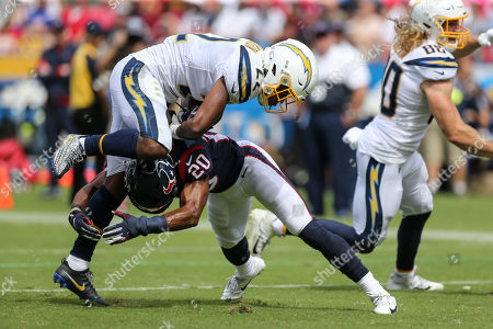 Carson, CA...Houston Texans strong safety Justin Reid #20 tackles Los Angeles Chargers running back Justin Jackson #22 during the NFL Houston Texans vs Los Angeles Chargers at the Dignity Health Sports Park in Carson, Ca on , (Photo by Jevone Moore)