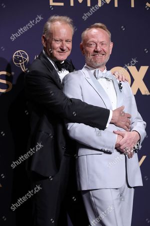Stellan Skarsgard and Jared Harris pose in the press room at the 71st Primetime Emmy Awards, at the Microsoft Theater in Los Angeles