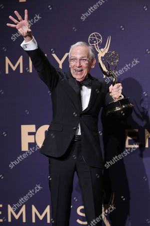 """Don Roy King poses in the press room with his award for outstanding directing for a variety series for """"Saturday Night Live"""" at the 71st Primetime Emmy Awards, at the Microsoft Theater in Los Angeles"""