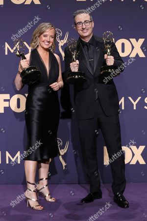 Liz Stanton, left, winner of the award for outstanding variety talk series, and John Oliver, winner of the awards for outstanding writing for a variety series and outstanding variety talk series, pose in the press room at the 71st Primetime Emmy Awards, at the Microsoft Theater in Los Angeles