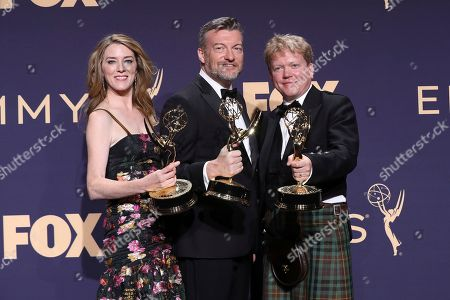 "Annabel Jones, from left, Charlie Brooker and Russell McLean pose in the press room with the award for outstanding television movie for ""Black Mirror: Bandersnatch"" at the 71st Primetime Emmy Awards, at the Microsoft Theater in Los Angeles"