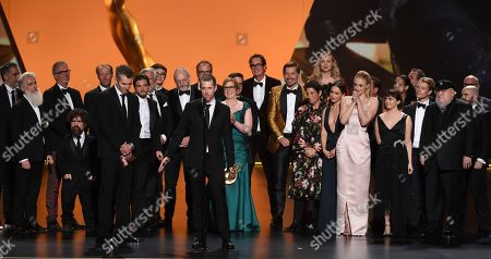 "David Benioff, D. B. Weiss, Carolyn Strauss, Bernadette Caulfield, Frank Doelger, David Nutter, Miguel Sapochnik, Vince Gerardis, Guyman Casady, George R. R. Martin, Bryan Cogman, Chris Newman, Greg Spence, Lisa McAtackney, Duncan Muggoch. D. B. Weiss and the team from ""Game Of Thrones"" accepts the award for outstanding drama series at the 71st Primetime Emmy Awards, at the Microsoft Theater in Los Angeles"