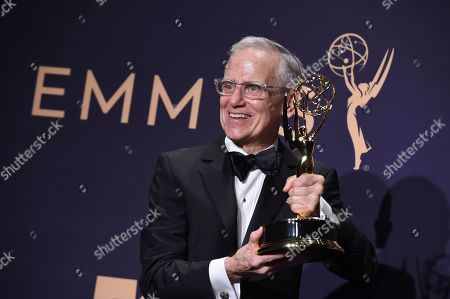 """Don Roy King poses in the press room with the award for outstanding directing for a variety series for """"Saturday Night Live"""" at the 71st Primetime Emmy Awards, at the Microsoft Theater in Los Angeles"""