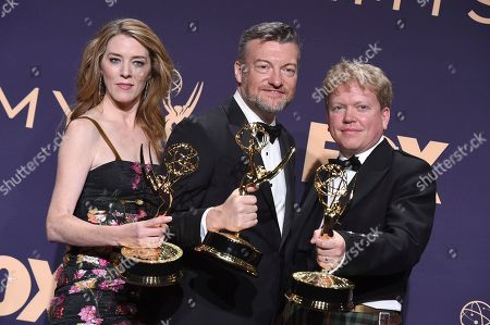 "Annabel Jones, Charlie Brooker, Russell McLean. Annabel Jones, from left, Charlie Brooker and Russell McLean poses in the press room with the award for outstanding television movie for ""Black Mirror: Bandersnatch"" at the 71st Primetime Emmy Awards, at the Microsoft Theater in Los Angeles"