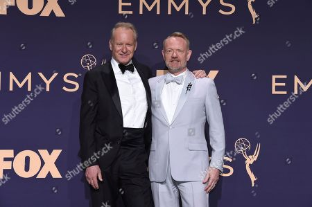 """Stellan Skarsg'rd, Jared Harris. Stellan Skarsgard, left, and Jared Harris, stars of the Emmy winning limited series """"Chernobyl,"""" pose in the press room at the 71st Primetime Emmy Awards, at the Microsoft Theater in Los Angeles"""