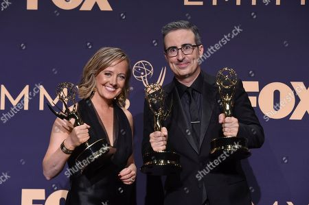 Stock Picture of Liz Stanton, John Oliver. Liz Stanton, left, winner of the award for outstanding variety talk series, and John Oliver, winner of the awards for outstanding writing for a variety series and outstanding variety talk series, pose in the press room at the 71st Primetime Emmy Awards, at the Microsoft Theater in Los Angeles