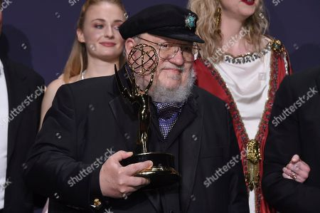 "George R. R. Martin poses in the press room with the award for outstanding drama series for ""Game of Thrones"" at the 71st Primetime Emmy Awards, at the Microsoft Theater in Los Angeles"
